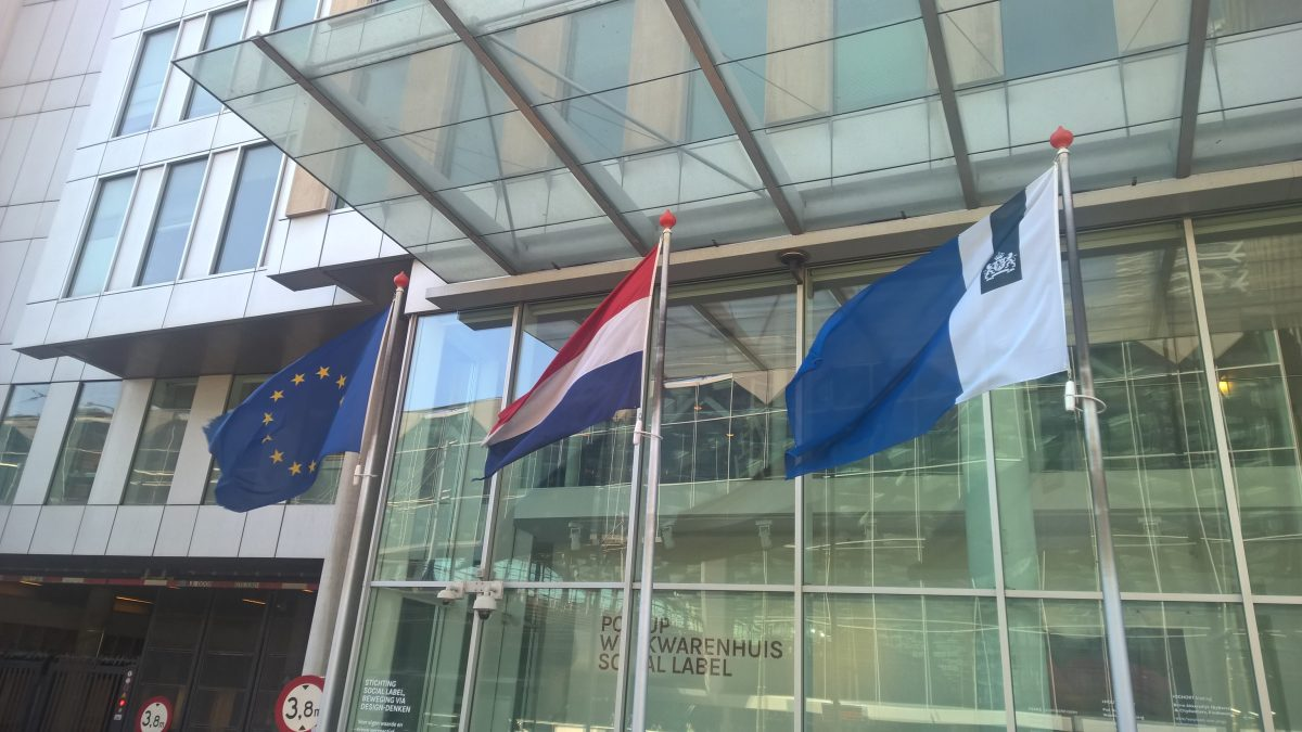 Dutch_national_and_government_flags_and_EU_flag_in_the_Hague-e1504174758492